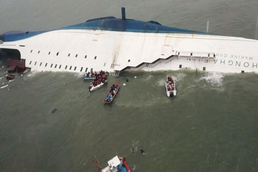 South Korean ferry, Sewol is seen sinking in the sea off Jindo on April 16, 2014. -- PHOTO: REUTERS