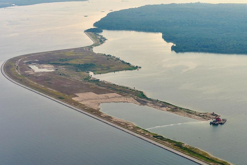An aerial view of the extent of land reclamation done around Pulau Tekong. -- ST PHOTO:ALPHONSUS CHERN
