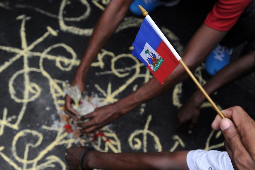 A voodoo ceremony is performed on June 5, 2014. Hundreds of children are believed to have been kidnapped in Africa and brought to Britain for brutal voodoo rituals, a United Nations watchdog said, urging London to do more to combat the scourge. -- PH