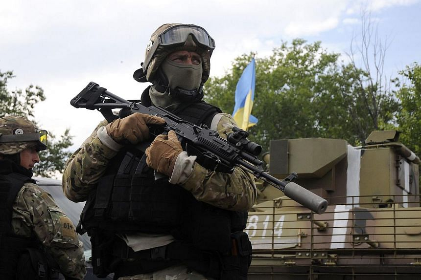 Ukrainian servicemen stand at the military camp near the town of Svyatogorsk in Eastern Ukraine, on June 20, 2014. Russia said a ceasefire announced by Ukrainian President Petro Poroshenko on Friday was not a peace offer but an ultimatum to pro-Russi