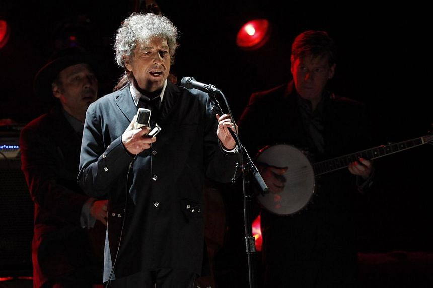 Singer Bob Dylan performs during a segment honoring Director Martin Scorsese, recipient of the Music+ Film Award, at the 17th Annual Critics' Choice Movie Awards in Los Angeles on Jan 12, 2012. -- PHOTO: REUTERS
