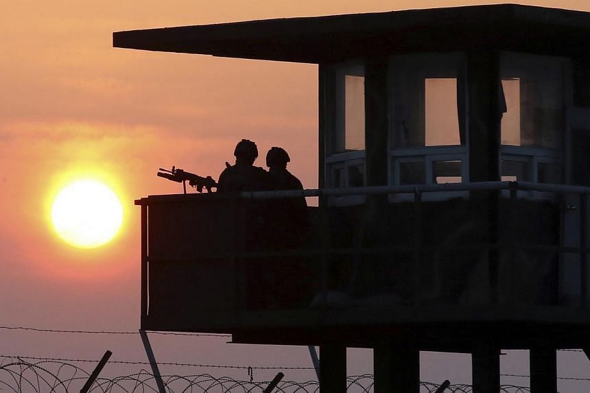 South Korean marines stand guard at a guard post on Baengnyeongdo, an island near the border with North Korea on April 2, 2014. A South Korean soldier on Saturday, June 21, 2014, shot and killed five members of his own unit at a guard post on th
