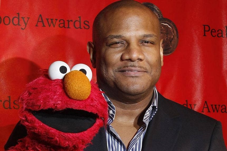 Voice actor Kevin Clash arrives with the puppet Elmo for the 2010 Peabody Award ceremony at the Waldorf Astoria in New York in this file photo taken May 17, 2010. A federal judge in Pennsylvania has dismissed a lawsuit accusing Clash, the puppeteer k