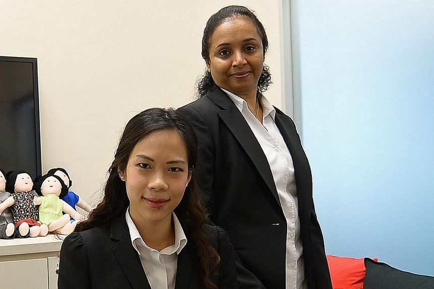 The courtroom (above), made using Lego toys, helps children understand how the courts work. (Right) Prosecutors Carene Poh and N. K. Anitha say the room helps children relax.