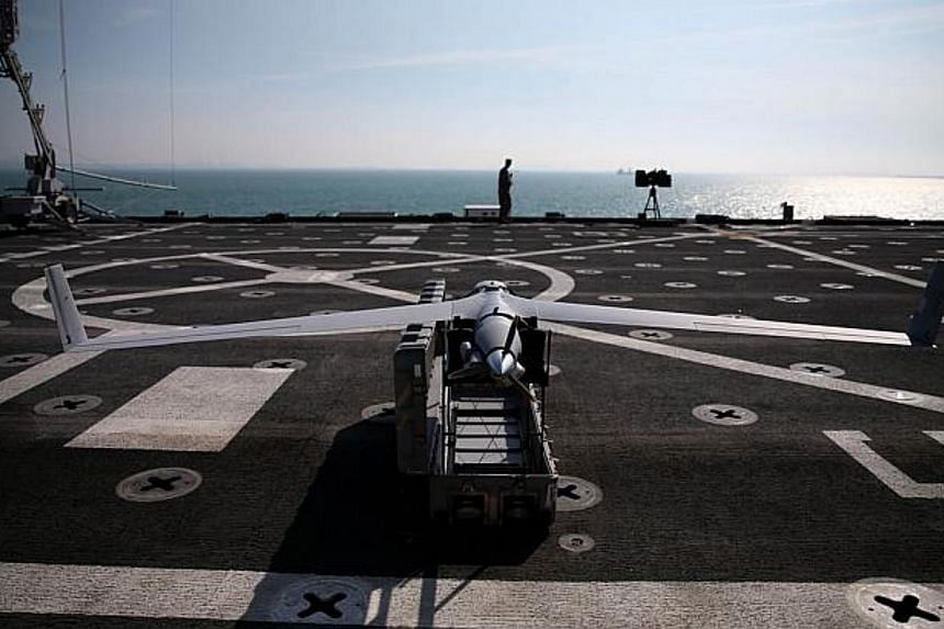 A Scan Eagle drone sits on the deck of the USS Ponce, on Dec 6, 2013 in Manama, Bahrain. -- PHOTO: AFP