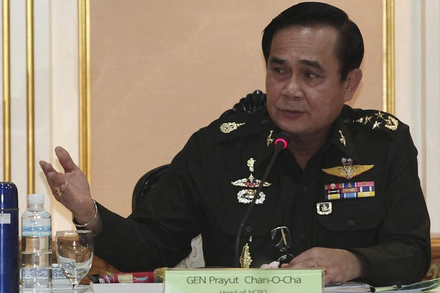 Thai Army chief General Prayuth Chan-ocha speaking during a meeting with members of the International Chamber of Commerce at the Royal Thai Army Headquarters in Bangkok on June 19, 2014. -- PHOTO: REUTERS