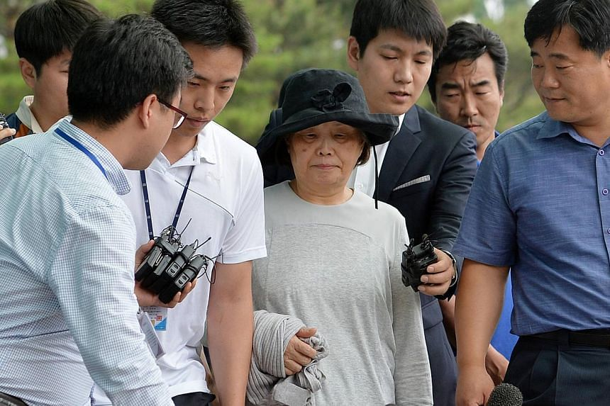 Ms Kwon Yoon Ja (centre), 72, who is the wife of Mr Yoo Byung Un, arriving at Incheon District Prosecutors' Office in Incheon on June 21, 2014. The wife of South Korea's most wanted man, a businessman linked to a ferry disaster in which hundreds of s