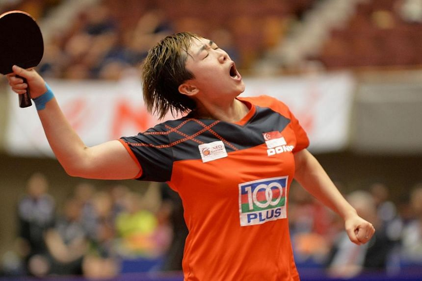 Singapore's Feng Tianwei reacts after beating Japan's Kasumi Ishikawa in their women's singles final at the Japan Open table tennis tournament in Yokohama on June 22, 2014.Singapore paddler Feng Tianwei claimed the women's single title at the I