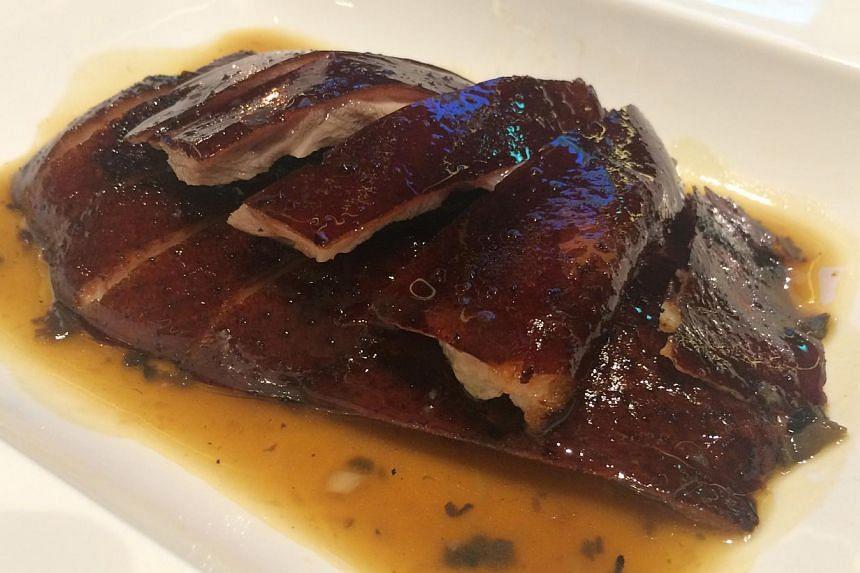 The Black Truffle Roasted Duck With Perigord Truffle boasts tender, juicy meat under aromatic, crispy skin. -- PHOTO: WONG AH YOKE, GRAND MANDARIN