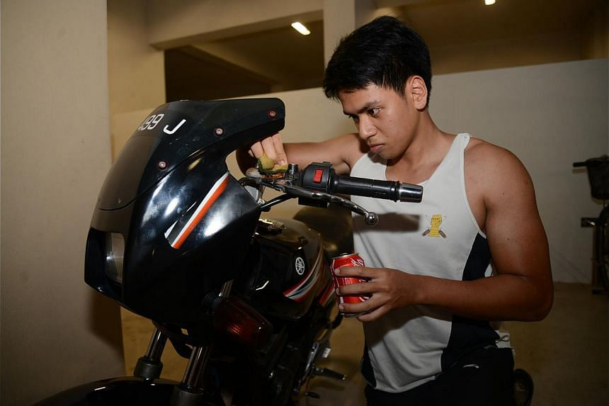 MOTORCYCLE CARE: Student Raihan Rahim watched a video on using Coca-Cola to remove rust and has since been using the technique on his motorcycle once a month. -- PHOTO: BENSON ANG