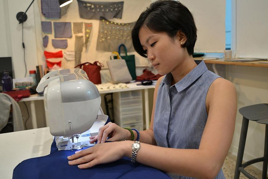 SEWING TECHNIQUES: Bag designer Tiffany Loy (above) learnt how the walking foot on a sewing machine worked. -- PHOTO: BENSON ANG