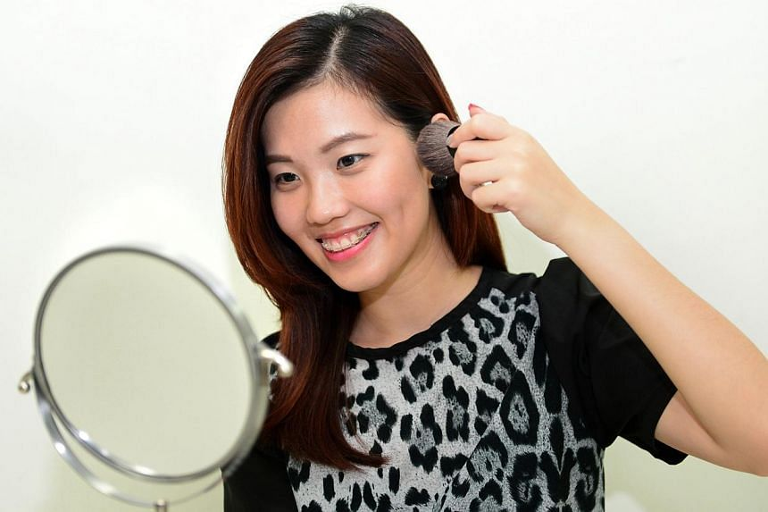MAKE-UP SKILLS: Ms Karen Lim (above) learnt almost all her make-up skills from YouTube and her mother and two sisters now rely on her to do their make-up when they attend wedding dinners. -- PHOTO: NG SOR LUAN
