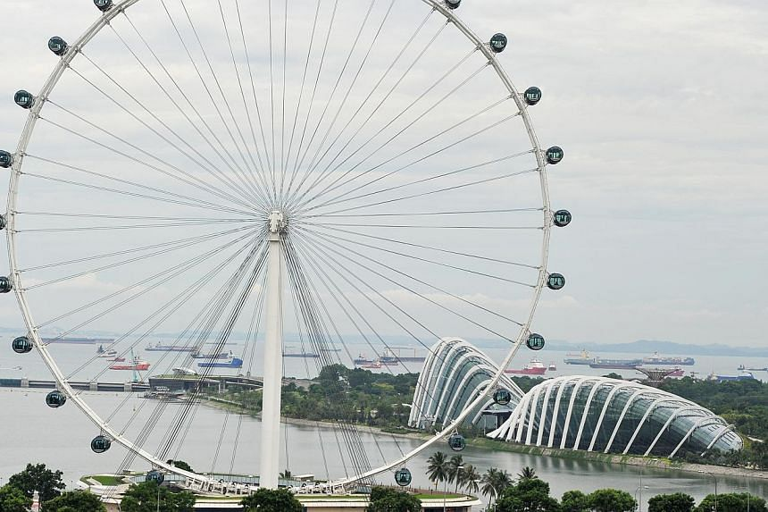 The Singapore Flyer (above), South Beach and Old Kallang Airport are some areas Zouk founder Lincoln Cheng considered moving the Jiak Kim Street club to. Last Friday, the club launched an online appeal for a lease extension. -- PHOTOS: LIM YAOHUI FOR
