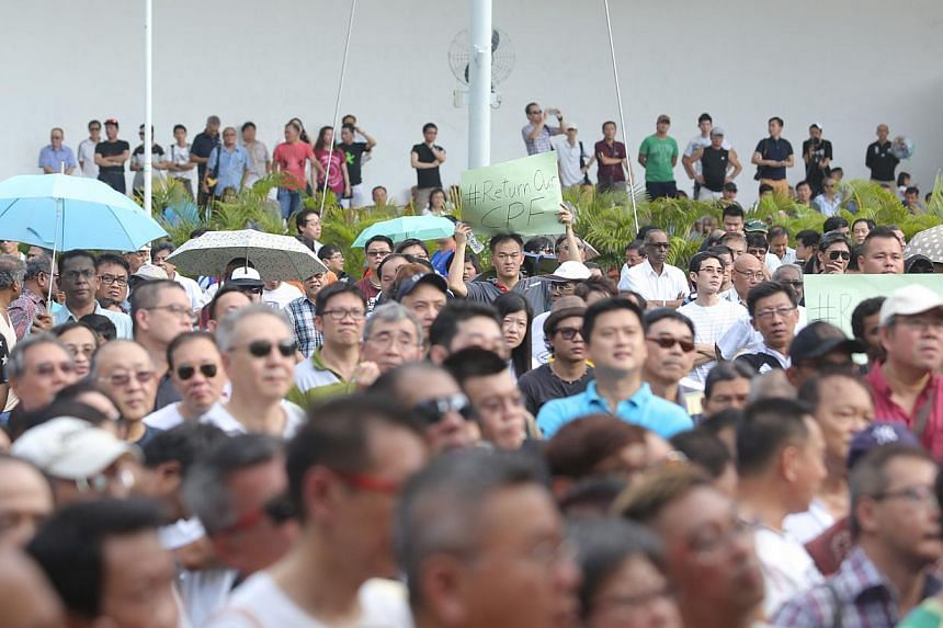 """Crowd at the """"Return Our CPF"""" protest at Hong Lim Park on June 7, 2014. -- ST PHOTO: ONG WEE JIN"""