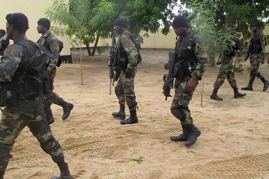 This photo taken on June 17, 2014 in the border town of Amchide, northern Cameroon, shows members of Cameroon's army elite force BIR (Brigade d'Intervantion Rapide, or Quick-Response Brigade), deployed as part of a reinforcement of its military actio