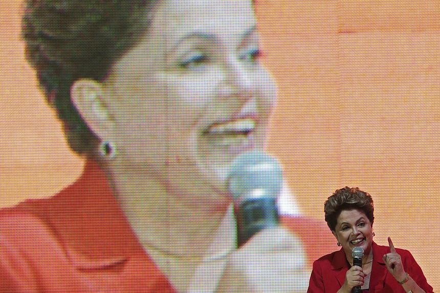 Brazil's President Dilma Rousseff gestures while speaking during the national convention of her Workers' Party (PT) in Brasilia on June 21, 2014. -- PHOTO: REUTERS