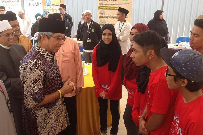 New activities for this year's Ramadanwere launched by Minister-in-charge of Muslim Affairs Yaacob Ibrahim on Sunday morning, at the Ahmad Ibrahim Mosque in Sembawang. -- ST PHOTO: AUDREY TAN