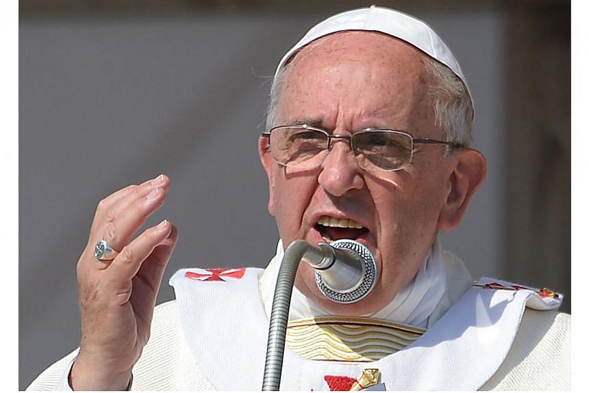 Pope Francis delivers his homily as he celebrates mass in Sibari, in the southern Italian region of Calabria at the end of his one-day visit in the city, on June 21, 2014. -- PHOTO: AFP