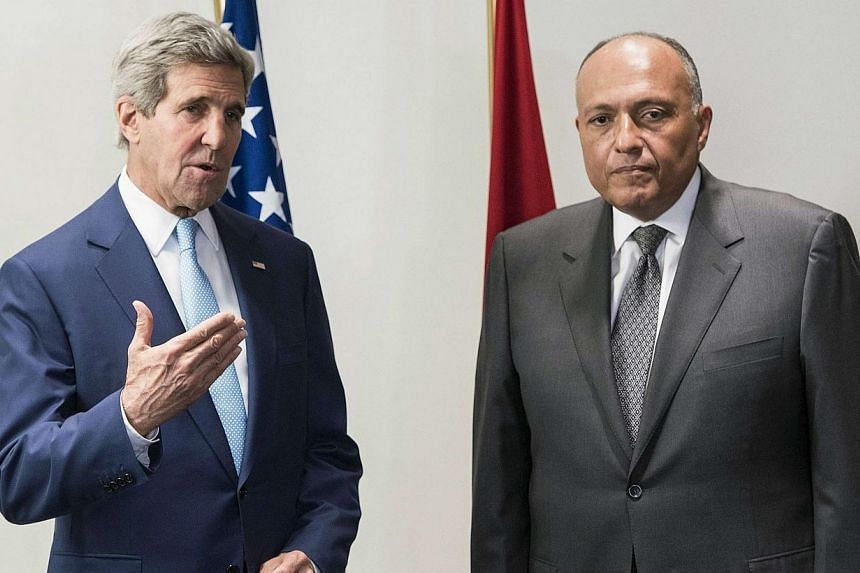U.S. Secretary of State John Kerry (left) and Egyptian Foreign Minister Sameh Shoukri address the media before a meeting at a hotel in Cairo on June 22, 2014.US Secretary of State John Kerry on a surprise Egypt visit on Sunday urged Iraqi leade