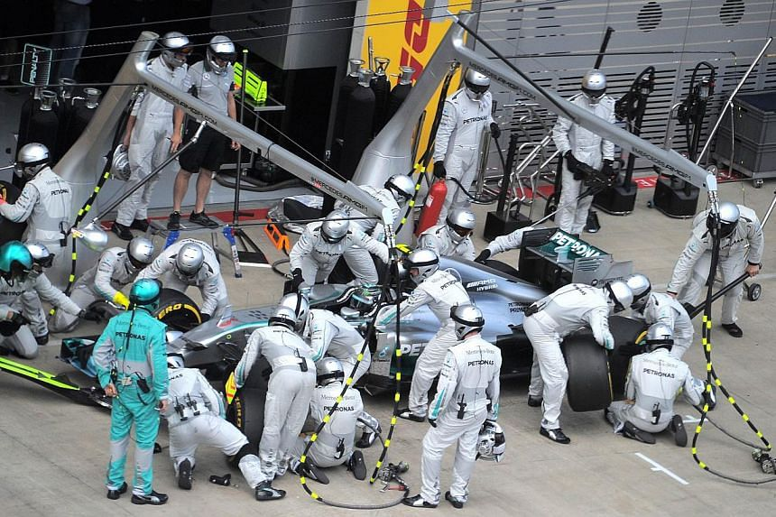 Mercedes' German driver Nico Rosberg makes a pit stop as he competes in the Austrian Formula One Grand Prix at the Red Bull Ring in Spielberg on June 22, 2014. -- PHOTO: AFP