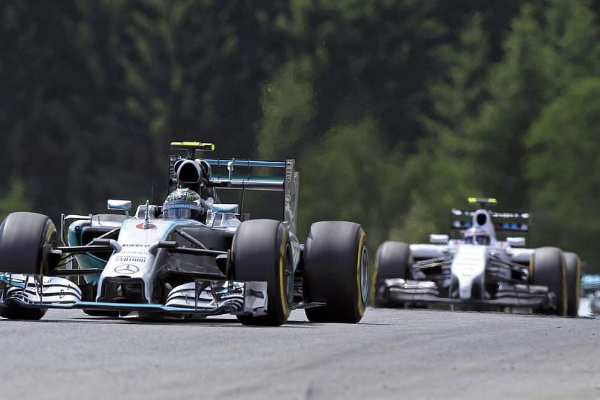 Mercedes Formula One driver Nico Rosberg of Germany is followed by Williams Formula One driver Valtteri Bottas of Finland (right) during the Austrian F1 Grand Prix at the Red Bull Ring circuit in Spielberg on June 22, 2014. -- PHOTO: REUTERS