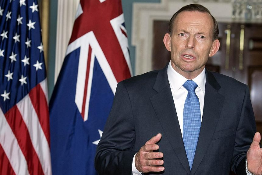 "Australian Prime Minister Tony Abbott speaks during a photo opportunity on June 12, 2014. Australian Prime Minister Tony Abbott is ""a sexist"" rather than a misogynist, a retiring politician from his party said in an interview on Sunday. -- PHOTO: AFP"