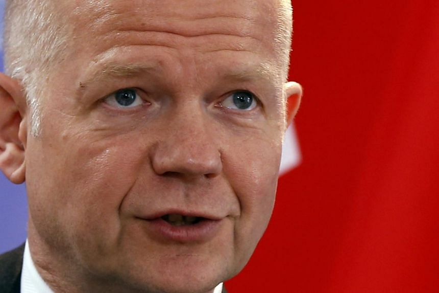 """British Foreign Secretary William Hague says """"a lot ofwork"""" has gone into preparing wider sanctions on Russia. PHOTO: REUTERS"""