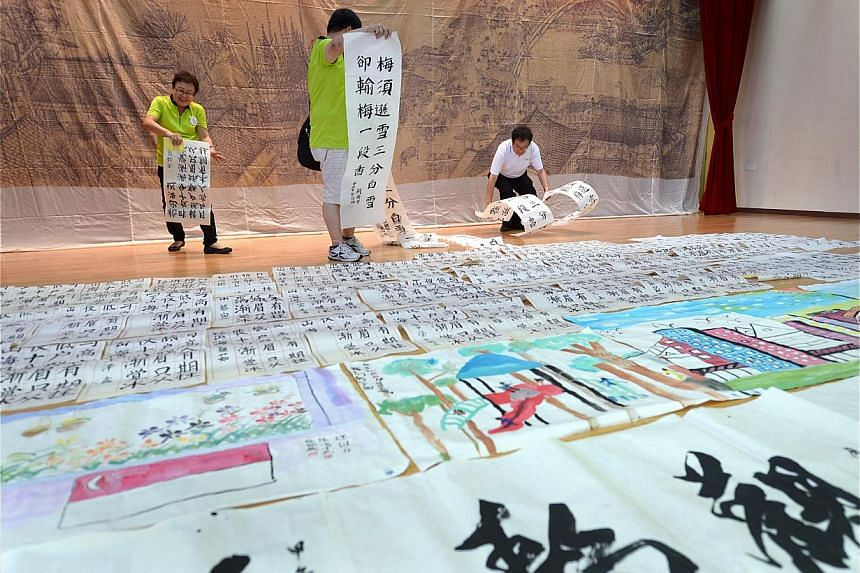 Works of calligraphy and Chinese brush paintings by residents and artists being displayed at the Braddell Heights Community Club. Fabric paintings depicting areas in Kampong Glam and colourful cubic-like clouds on show at the Kampong Glam Community C