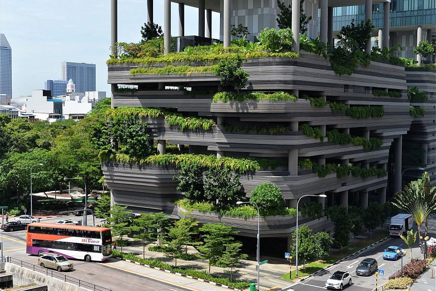 The Ocean Financial Centre (above) last held the record for being the world's largest vertical garden before The Tree House (top right) clinched it. The vertical garden at Parkroyal on Pickering is one of the 154 such projects in Singapore. Mr Bernar