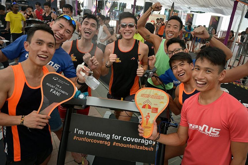 Participants at Mount Elizabeth Hospital's Run for Cover Challenge, where teams took turns to run on treadmills for 24 hours non-stop.