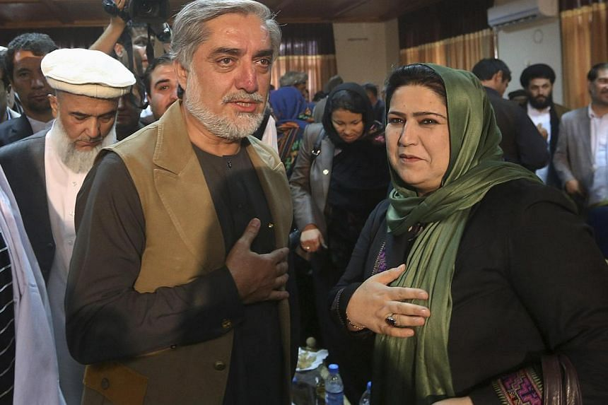 Afghan presidential candidate Abdullah Abdullah (L) leaves after a news conference in Kabul June 23, 2014. Abdullah's campaign team on Sunday released telephone recordings that it said were conversations of Amarkhail arranging ballot-box stuffin