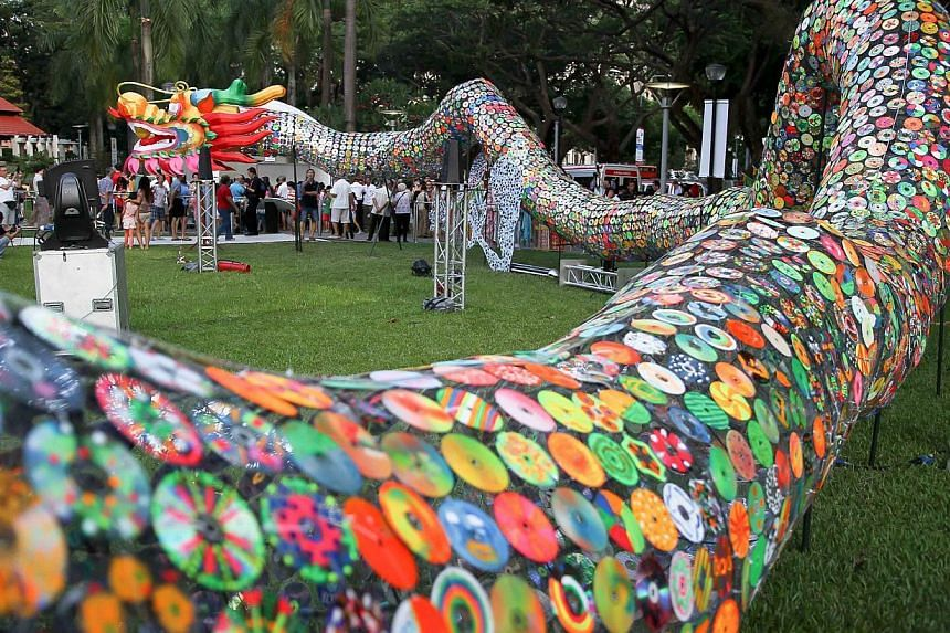 As part of the PAssionArts Festival 2014, artists and residents jointly created an 88m long dragon out of old CDs. -- PHOTO: PASSIONARTS FESTIVAL 2014