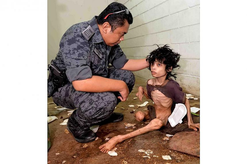 The teenager, Muhammad Firdaus Dullah was covered in filth and his own faeces when found by Immigration officers at the flat in Taman Semarak in Nilai. -- PHOTO: THE STAR PUBLICATION