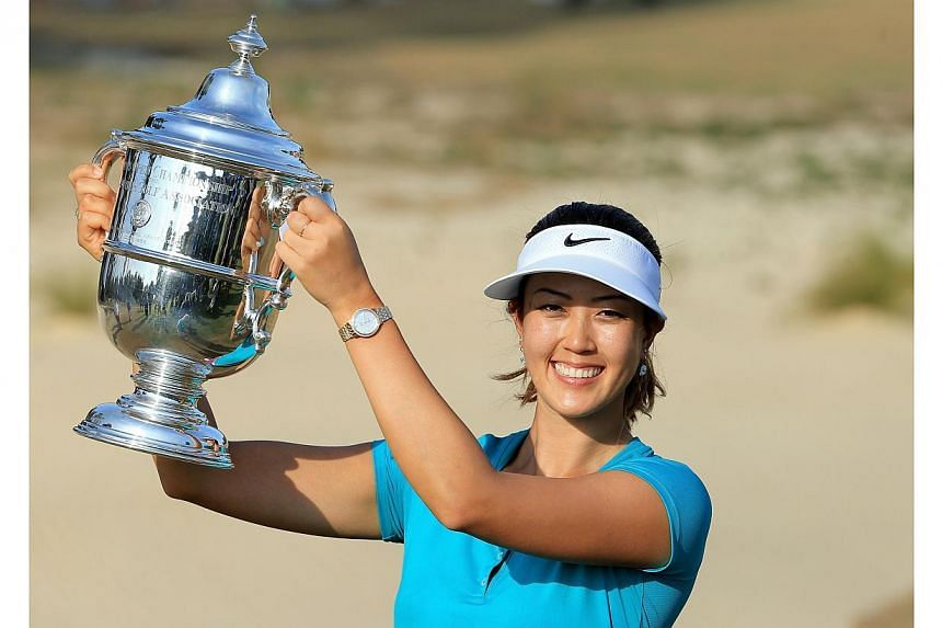 Michelle Wie of the USA proudly holds the trophy after her victory during the final round of the 69th US Women's Open at Pinehurst Resort & Country Club, Course No 2, in Pinehurst, North Carolina on June 22, 2014. -- PHOTO: AFP