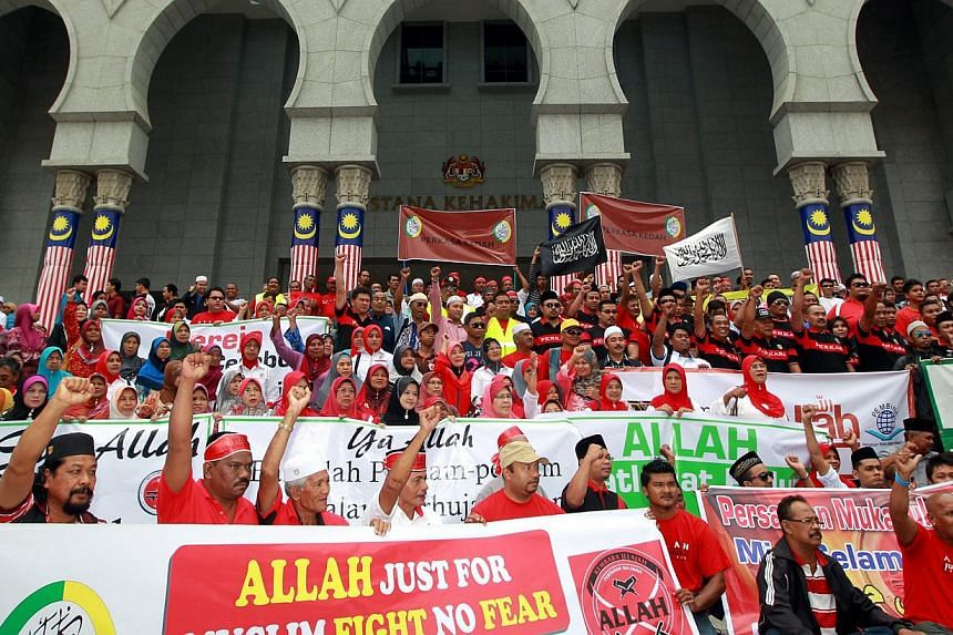 """In this file picture from September 2013, a crowd gathers to hear the case to use word """"Allah"""" outside the Palace of Justice in Putrajaya. On Monday, the years-long legal wrangle came to an end when the Federal Court dismissed a bid by Ca"""