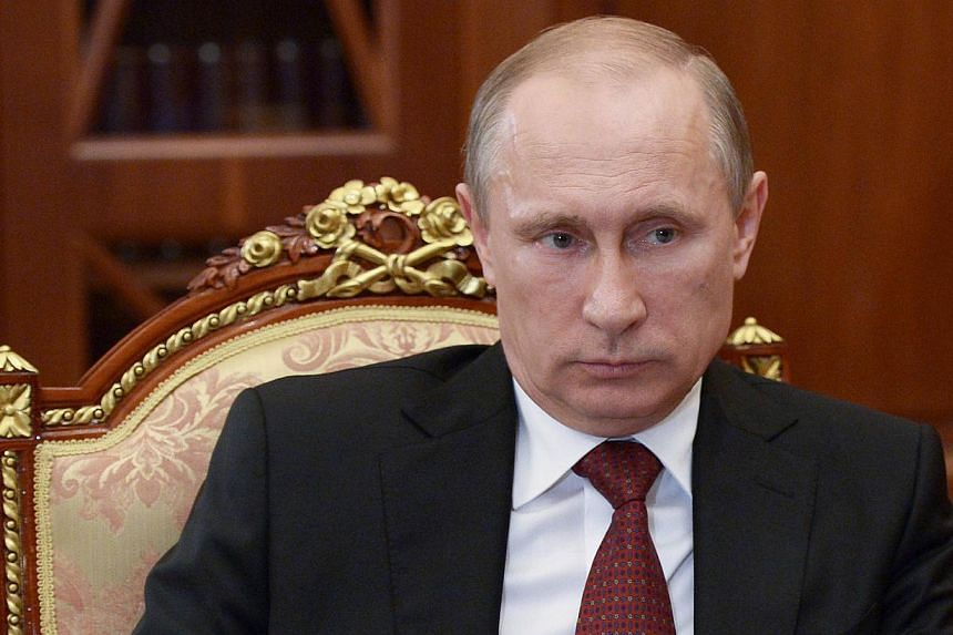 Russia's President Vladimir Putin attends a meeting in the Kremlin in Moscow, on June 20, 2014. -- PHOTO: AFP