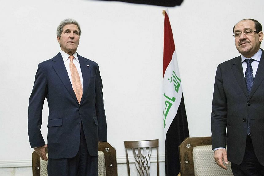 U.S. Secretary of State John Kerry (left) meets with Iraqi Prime Minister Nuri al-Maliki at the latter's office in Baghdad on June 23, 2014.US Secretary of State John Kerry was in Baghdad Monday to push for stability, as Sunni militants seized