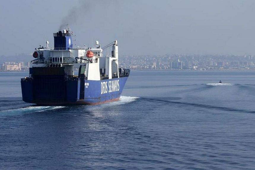 """A handout picture taken on Jan 7, 2014, and released by Norwegian Armed Forces shows the Danish cargo ship """"Ark Futura"""" arriving at the Syrian port of Latakia before being loaded with Syria's chemical agents before their transfer out of the country f"""
