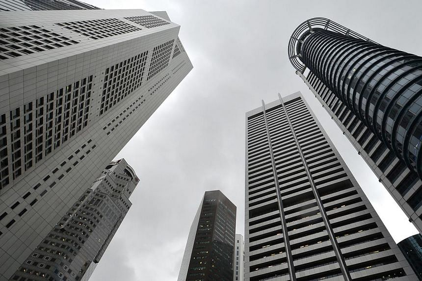 Office rents in the central business district (CBD) jumped in the second quarter this year and are likely to continue rising for the next 12 months due to limited supply, property consultancy JLL said. -- PHOTO: ST FILE