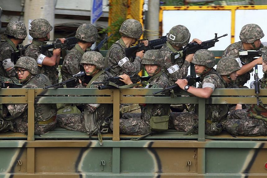 South Korean soldiers on a military vehicle take their position during a search and arrest operation in Goseong June 22, 2014. -- PHOTO: REUTERS