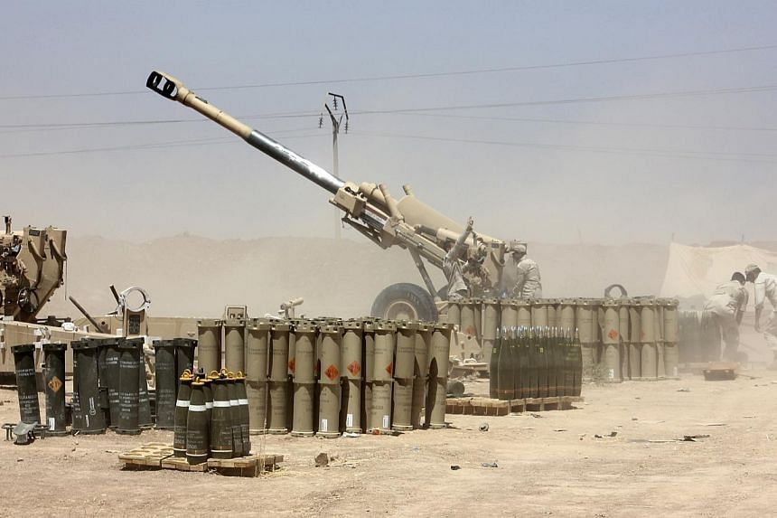 Iraqi security forces fire artillery during clashes with Sunni militant group Islamic State of Iraq and the Levant (ISIL) on the outskirts of the town of Udaim in Diyala province, on June 22, 2014. -- PHOTO: REUTERS