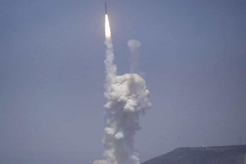 A flight test of the exercising elements of the Ground-Based Midcourse Defense system is launched by the 30th Space Wing and the US Missile Defense Agency at the Vandenberg AFB, California on June 22, 2014. -- PHOTO: REUTERS