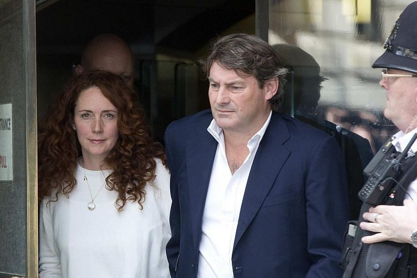 Former News International chief executive Rebekah Brooks (left) and her husband Charlie (right) leave the Old Bailey courthouse in London June 24, 2014.Former Rupert Murdoch confidante Rebekah Brooks was cleared of all charges while former News