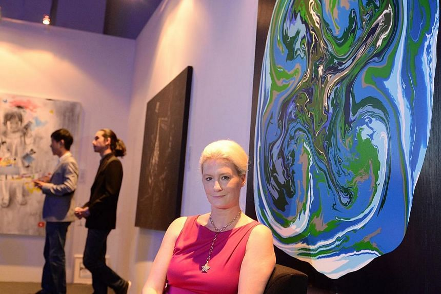 German- born, Singapore permanent resident Stefanie Hauger and her winning painting, Space Odyssey, which won both the newly introduced United Overseas Bank (UOB) South-east Asian Painting of the Year Award, and the UOB Painting of the Year Award (Si