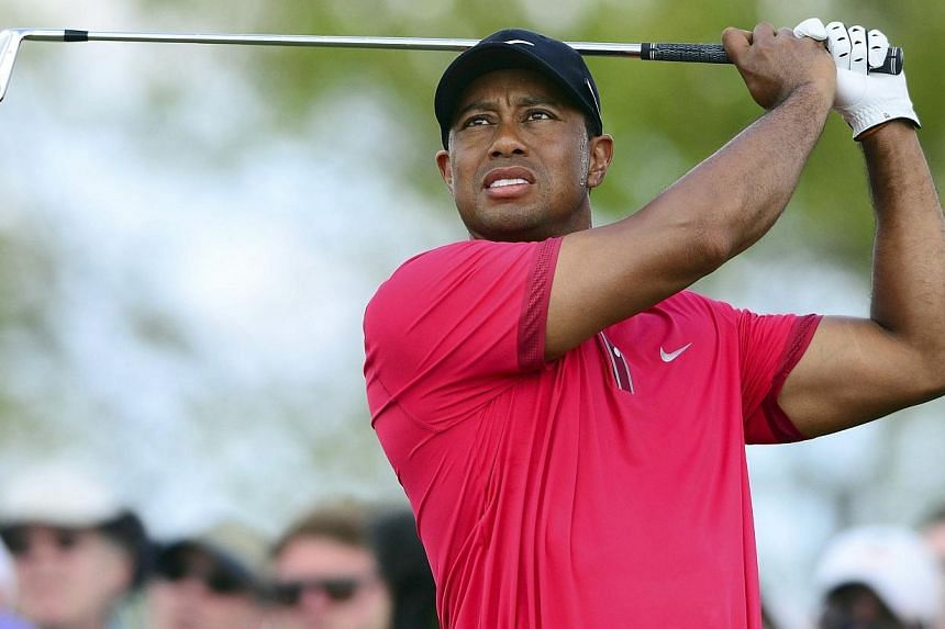 Tiger Woods tees off from the 4th hole during the final round of the WGC - Cadillac Championship golf tournament at TPC Blue Monster at Trump National Doral in this file photo taken in Miami, Florida March 9, 2014. Tiger Woods made final prepara