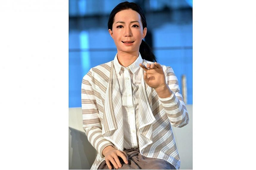 """The new humanoid robot named """"Otonaroid"""" gestures during a press preview at the National Museum of Emerging Science and Technology in Tokyo on June 24, 2014. -- PHOTO: AFP"""