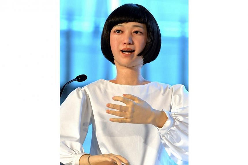 """The new humanoid robot named """"Kodomoroid"""" gestures at a press preview at the National Museum of Emerging Science and Technology in Tokyo on June 24, 2014. -- PHOTO: AFP"""