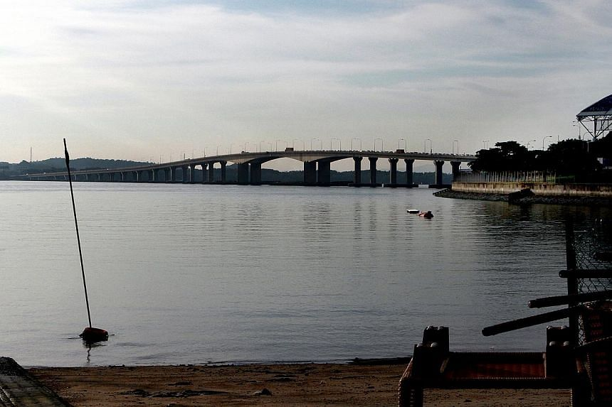 A view of the Second Link at Tuas from the Singapore side.Malaysia's Department of Environment has issued a temporary stop-work order against all coastal land reclamation works to build a man-made island in the Strait of Johor, the New Straits
