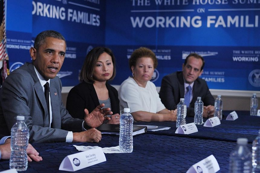 """United States President Barack Obama takes part in a round table discussion during the White House Summit on Working Families on June 23, 2014, in Washington, DC.Mr Obama said on Monday that the United States was on its """"lonesome"""" as the on"""