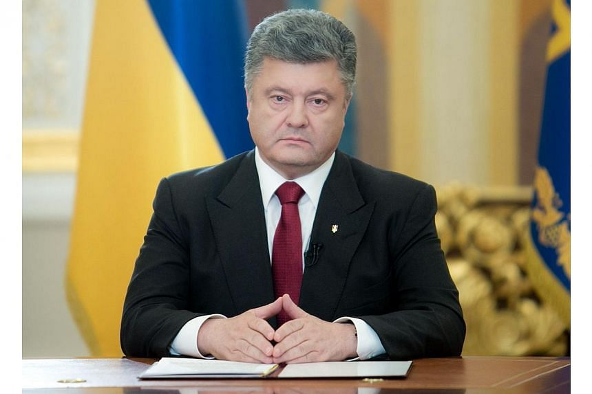 Handout picture taken and released by Ukrainian presidential press service on June 21, 2014 shows Ukrainian President Petro Poroshenko (centre) during his broadcast address to the nation.Ukrainian President Petro Poroshenko said on Tuesday, Jun